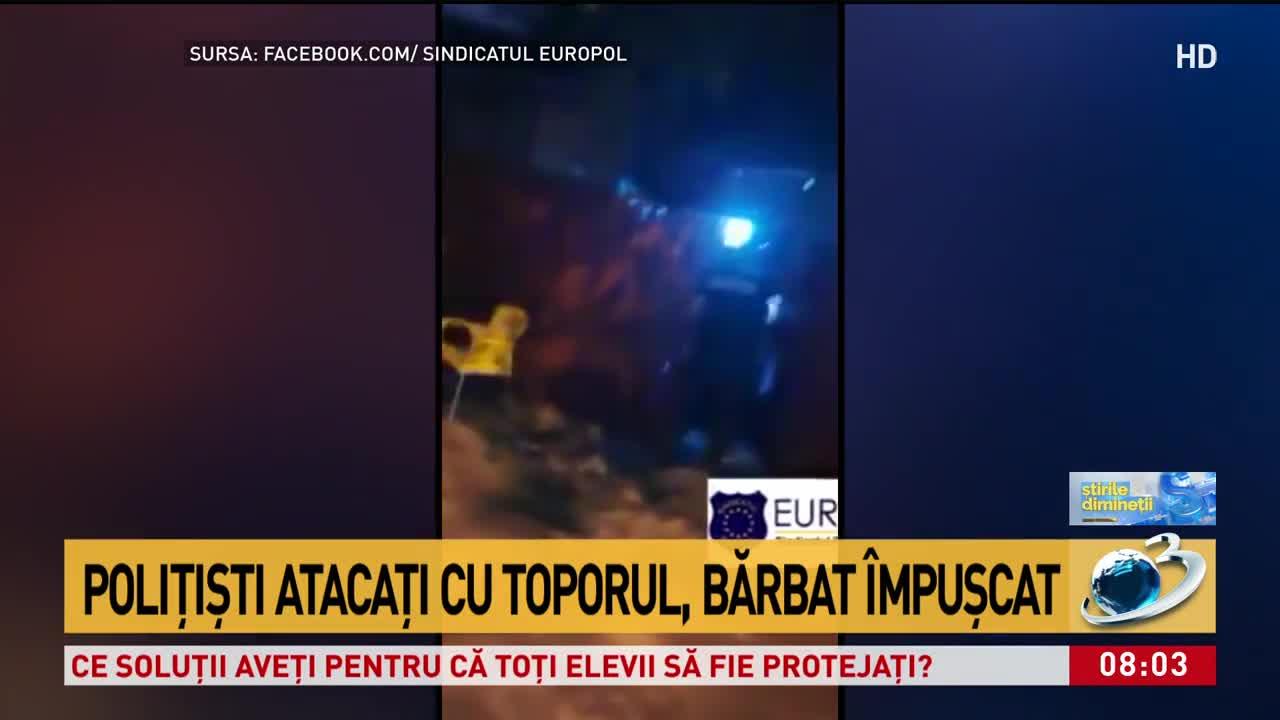 Polițiști atacați cu toporul, bărbat împușcat